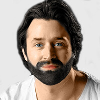 headshot image of beard man wearing a white shirt on top