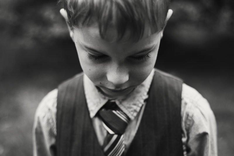 a young boy wearing a tuxedo
