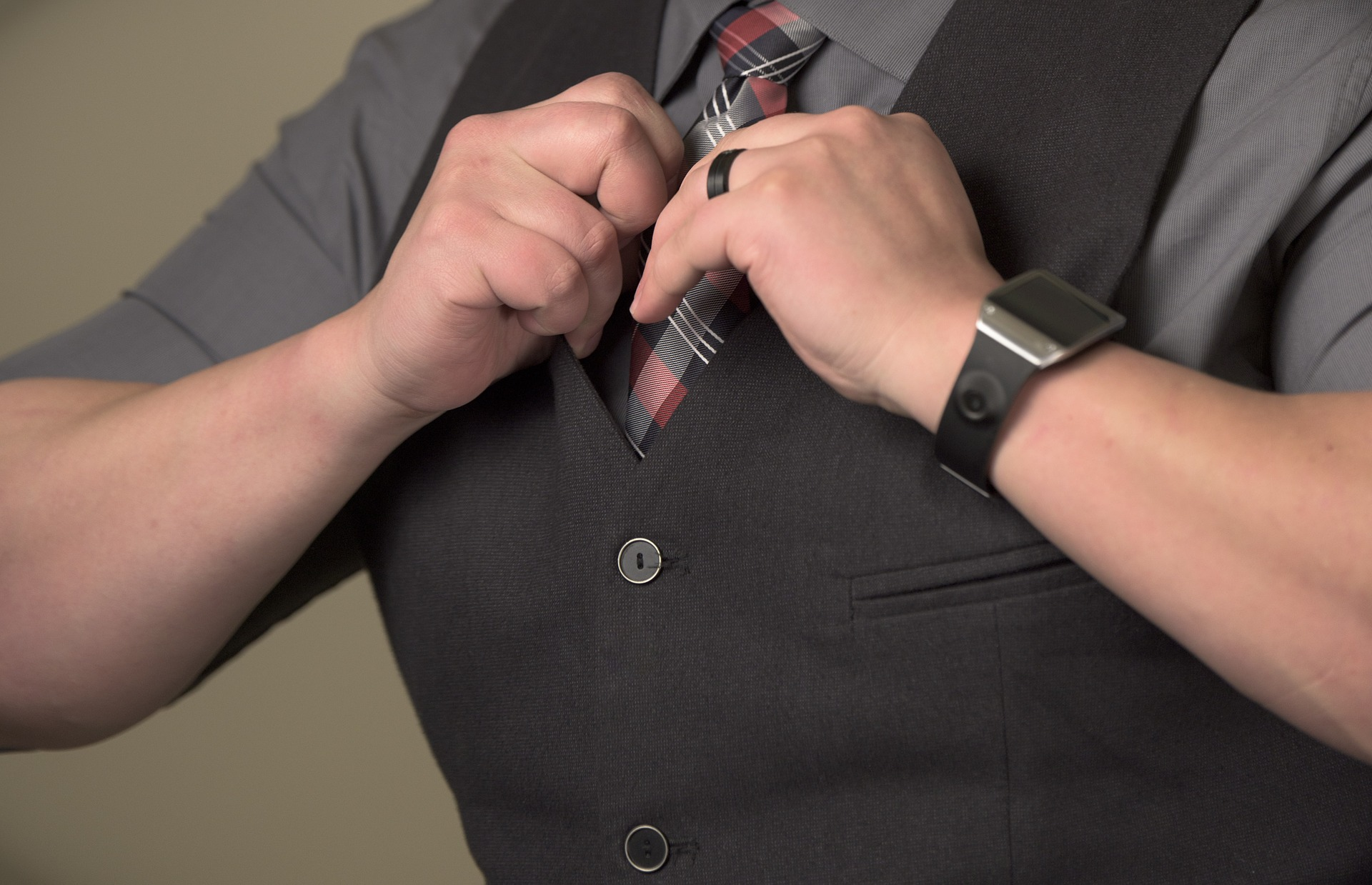 a man fixing his necktie
