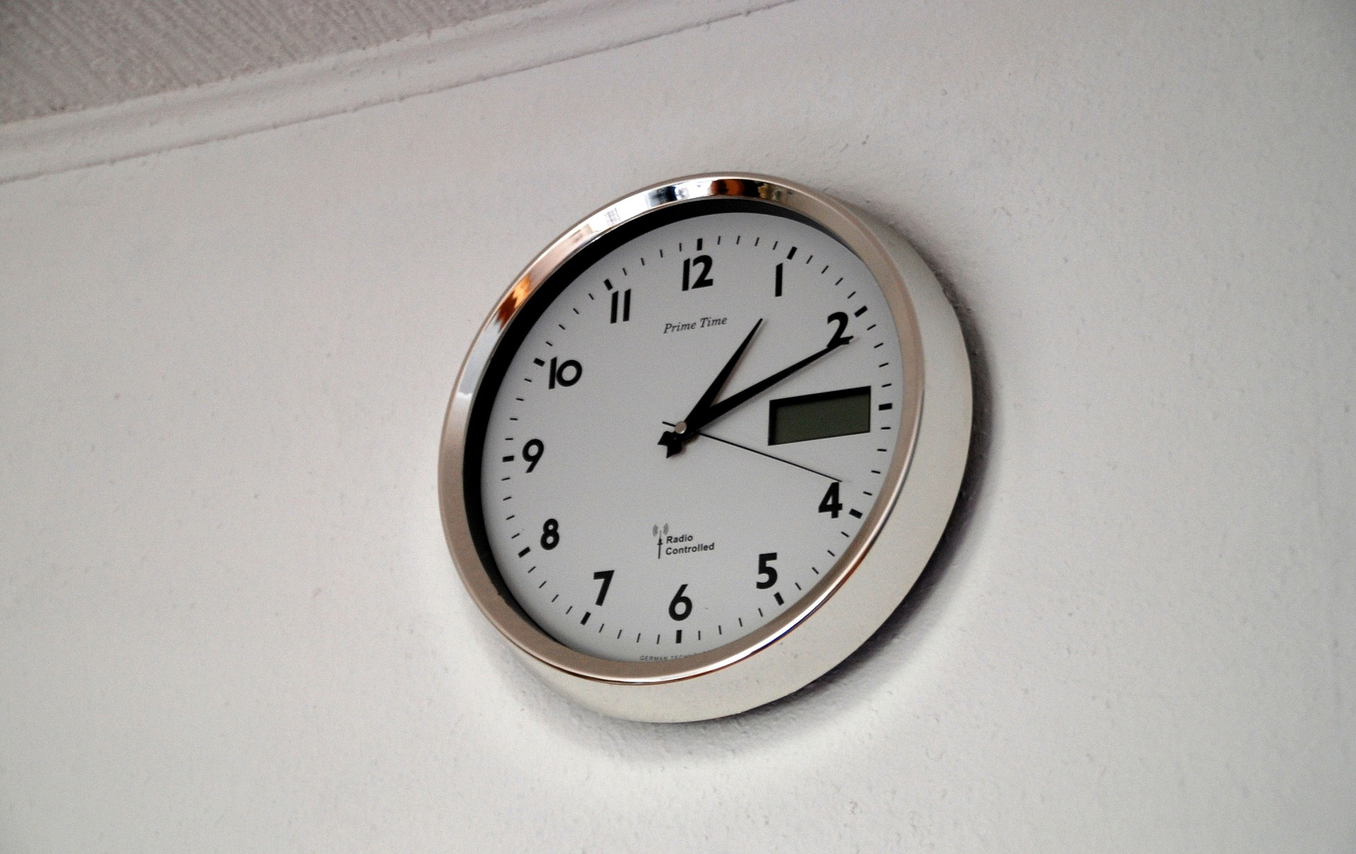 a wall clock place properly on a wall;