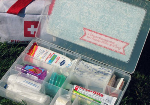 A transparent medicine box with a first aid things on it.