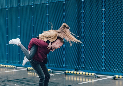 a man who piggyback ride his woman and have fun with each other