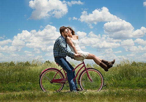 a couple riding bicycle together with quality time